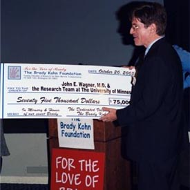 Dr. Wagner receiving check