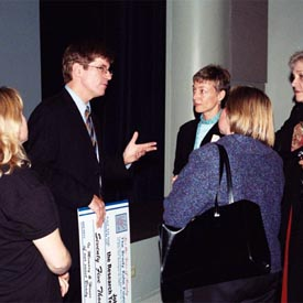 Dr. Wagner talking with people after event